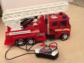 Remote control fire engine with flashing lights and horn