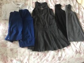 Large bundle of girls school uniform, pinafores, shirts , dresses. All from Next to Matalan