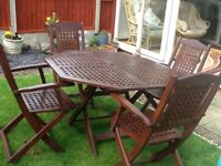 Set of four garden wooden fold up chairs and wooden table