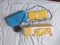 nintendo switch lite with case and mario hardly used