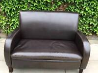 Small faux leather brown couch