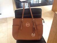 Michael Kors very large tan handbag. Used once. As new.