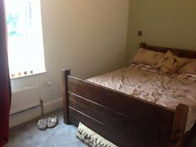 Solid wooden bed frame (double) for sale