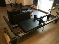 Pilates reformer bed, jumpboard and box- balanced body