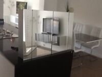 Bathroom mirrored cabinet with battery operated lighting
