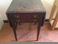 antique drop leaf table with drawers and carving