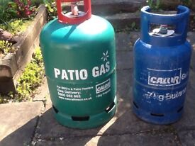 Two empty bbq gas cylinders.