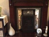 Wooden fire surround and Rennie Mankintosh style fireplace
