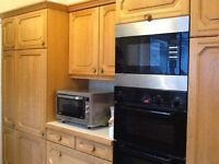 Large collection of SOLID WOOD kitchen units, worktop, sink and appliances