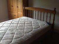 Wooden double bed with mattress for sale in excellent condition