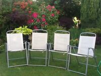 Patio set .....four comfortable chairs and oval frosted glass top very good condition.