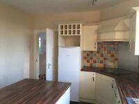 Kitchen - Riverside kitchen cream units with walnut effect worktops