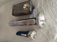 Three vintage torches