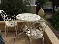 Lovely cream iron table and 2 chairs