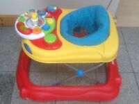 £15-baby walker with removable battery operated musical console-padded seat is washed