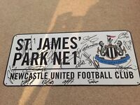Signed NUFC road sign, by players from 2016/17