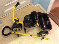 Child's tricycle. Pedals and push bar. Safety harness.