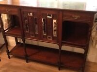 Solid oak sideboard with inlaid mirrors,very unique.