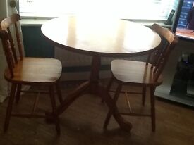 Farmhouse style table and two chairs