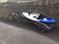 NEW UNUSED KAYAK (Trail Outdoor Adventurer) WITH BICYCLE TRAILER AND DETACHABLE FISHING STABILISERS