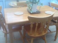 Lovely pine farmhouse table a 4 chairs in good new condition.