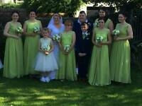 Green bridesmaid dresses and blue/navy boys suit
