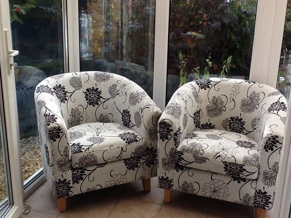 A pair of Coach house tub chairs larger the most