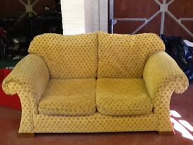 Gold / mustard coloured 2 seater sofa