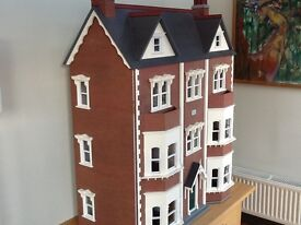 Fabulous four-storey dolls house complete with working lights and fireplaces