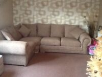 Stylish corner sofa with cuddle chair and pouffe