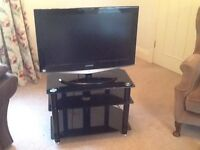 """Flat screen 32"""" free view television and stand"""