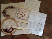 Embroidery kit with silks, design on printed fabric, hoops and zip with binding to make cushion