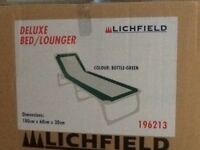 Camp bed lounger by Lichfield used once no longer required light weight easy fold up no assemble req