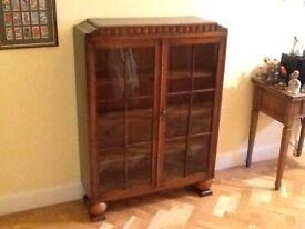 Dark wood display cabinet excellent condition .