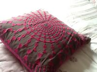 Pretty design cushion from John Lewis needs uplifted
