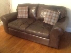 Brown leather 2 seater Laura Ashley Hampshire sofa. Reasonable clean condition. Buyer to collect.