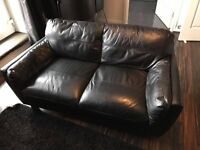 Black leather 2 and 3 seater sofas for a bargain price