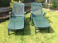 Pair of green sun loungers