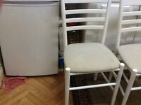 2 white dining table chairs in good condition