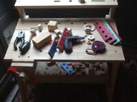 Childs wooden workbench and play tools