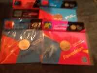 FIVE OLYMPIC FIFTY PENCE COINS.MINT AND IN PACKETS.see description