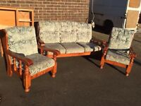 Sofa and chairs on a solid oak frame
