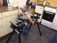 Evolution mitre saw with evolution stand. comes with a blade that cuts metal , wood and plastic