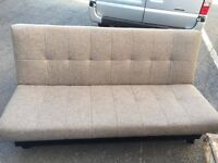 sofa bed finished in oatmeal colour upholstery brand new with scuff on one corner ( can be stitched)