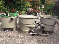 Recently dismantled koi pond system consisting of filter tanks aggregates brushes and foam.
