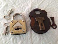 Two vintage locks and keys.