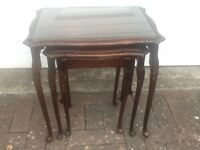 Mahogony wooden nest of tables with glass tops