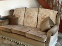 Three piece sofa with foot stool