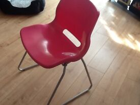 Pink plastic cantilever chair