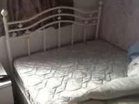 4 foot 6 inches Double bed, with mattress and attractive headboard